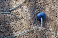 Close up of fishing net and ropes. In old harbor stock photo