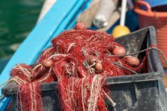 Close up of fishing nets on a boat. Close up of fishing nets with ropes and floats on a boat in the harbor Royalty Free Stock Image
