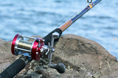 Close Up of Fishing Reel. Fishing reel and pole. Columbia River.  Shallow depth of field with selective focus Royalty Free Stock Photography