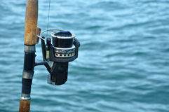 Close up of fishing reel in a fishing rod Stock Photo