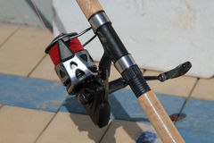 Close up of a fishing reel on a rod Stock Image