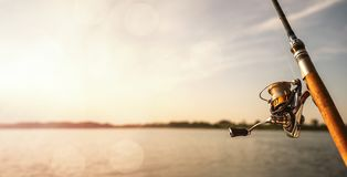 Close up of a fishing rod during the sunsete. Close up of a fishing rod during the sunset with copy space stock photography