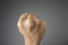 Close up fit. Close up fist on grey background Stock Images