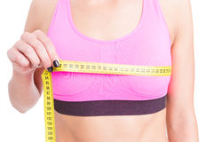 Close-up of fit lady measuring bust line Stock Image