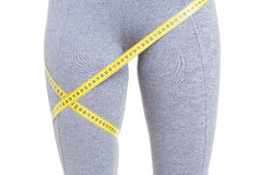Close-up of fit legs with measured by tape line Royalty Free Stock Images