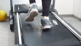 Close-up Fit Man in electric muscle stimulation suit for ems training running on treadmill at gym. Close-up Fit Man in electric muscle stimulation suit for ems stock video footage
