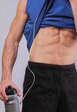Close up of fit and muscular man torso after workout exercise. Fittness  mann resting after morning run. Sport, active lifestyle c Royalty Free Stock Photography