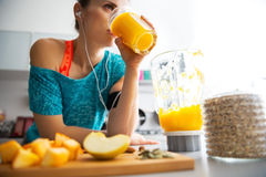 Close-up on fit woman drinking pumpkin smoothie Stock Photo