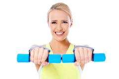Close up of fit woman while exercise with dumbbells Stock Photos