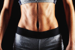 Close up of fit woman's torso with her hands Stock Photo