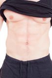 Close-up with fitness instructor male torso and abs. Muscle man chest and abdomen Royalty Free Stock Images