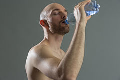 Close up of fitness man drinking water Stock Photos