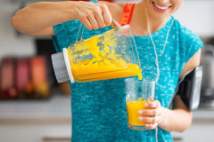 Close-up on fitness woman pouring pumpkin smoothie Royalty Free Stock Image
