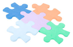 Close-up five colored puzzle blocks Stock Photos