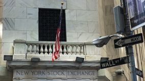 Close up of the flag above the entrance of the Stock Exchange on Wall Street
