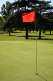 Close up Flag on the Green. A close up shot of a Red flag on the pin, marking this hole on the golf course stock images