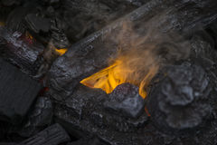Close up of flames in log fire in cozy warm Winter fireplace Stock Image