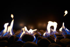 Close Up Of Flaming Coals On Gas Fire Stock Photo