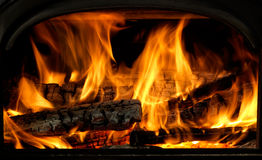 Close Up Of Flaming Logs On Fire stock photos