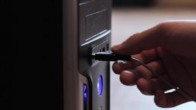 Close-up. The hand inserts the USB flash drive. Close up flash stick in modern computer USB socket stock footage