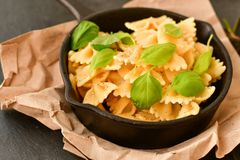 Farfalle. Close up of  Flavorful delicious   traditional italian meal pasta   farfalle with parmesan cheese   fresh basil and black pepper . Mediterranean food Royalty Free Stock Images