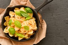 Farfalle. Close up of  Flavorful delicious   traditional italian meal pasta   farfalle with parmesan cheese   fresh basil and black pepper . Mediterranean food Royalty Free Stock Photography