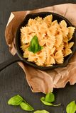 Farfalle. Close up of  Flavorful delicious   traditional italian meal pasta   farfalle with parmesan cheese   fresh basil and black pepper . Mediterranean food Royalty Free Stock Image