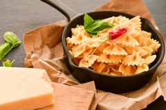 Farfalle. Close up of  Flavorful delicious   traditional italian meal pasta   farfalle with parmesan cheese   fresh basil and black pepper . Mediterranean food Royalty Free Stock Photos
