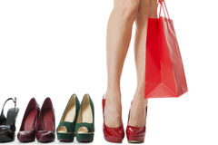 Close up Flawless Woman Legs in Glossy Red High Heel Shoes Standing Stock Photo