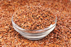 Close up of flax seeds and bowl food background Stock Image