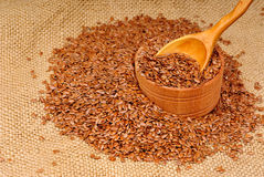 close up of flax seeds in wooden spoon and bowl Royalty Free Stock Photography
