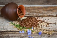 Close-up of flax seeds on wooden table royalty free stock photos