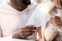 Close up of flight tickets in hands of beautiful couple. Long waited rest. Close up of two flight tickets kept in hands of splendid couple looking forward to Royalty Free Stock Photography