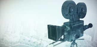 Composite image of close-up of flim camera with tripod. Close-up of flim camera with tripod against high angle view of city by river Royalty Free Stock Photography