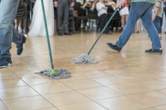 Close up of floor cleaning action with wiper. Cleaning and cleanliness concept. selected focus.  stock photos