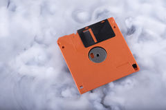 Close-up floppy disk in the clouds. Selective focus Royalty Free Stock Photo