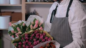 Close up florist hands. man making bunch at flower shop. people, business, sale and floristry concept. Bouquet with. People, business, sale and floristry concept stock video footage