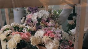 Close up florist hands. man making bunch at flower shop. people, business, sale and floristry concept. Bouquet with. People, business, sale and floristry concept stock footage