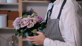 Close up florist hands. man making bunch at flower shop. people, business, sale and floristry concept. Bouquet with. People, business, sale and floristry concept stock video