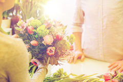 Close up of florist woman and man at flower shop Stock Images