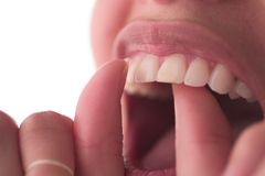 Close up flossing. Dental care concept: Floss your teeth Royalty Free Stock Photos