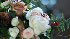 Close-up, flower bouquet in the rays of light, rotation, consists of Rose cappuccino, snowflake rose, rose yana creamy. Flower bouquet in the rays of light stock footage