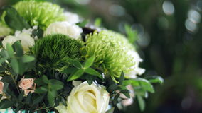 Close-up, Flower bouquet in the rays of light, rotation, the floral composition consists of Brunia green, Rose of. Close-up, Flower bouquet in the rays of light stock video footage