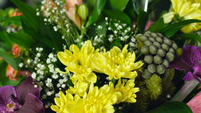 Close-up, Flower bouquet in the rays of light, rotation, the floral composition consists of calla, lily, Brunia green. Gypsophila, Orchid vanda, Alstroemeria stock video footage