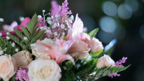 Close-up, flower bouquet in the rays of light, rotation, the floral composition consists of gerbera, Eustoma, Rose yana stock video footage