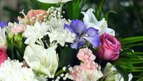 Close-up, Flower bouquet in the rays of light, rotation, the floral composition consists of Leucadendron, Chrysanthemum. Anastasis, Amaryllis pink, Orchid vanda stock footage