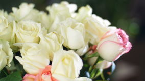 Close-up, Flower bouquet in the rays of light, rotation, the floral composition consists white Roses . in the background. A lot of greenery. Divine beauty stock video footage