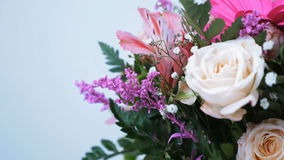 Close-up. Flower bouquet, rotation on white background, floral composition consists of gerbera, Eustoma, Rose yana stock footage