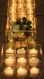 Close up of flower decor and candles on the dinner table royalty free stock photography