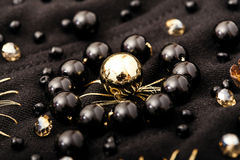 Close up flower of golden and black beads on black textile Stock Photos